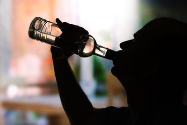 Silhouette of man drinking alcohol