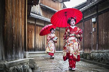 Maikos walking in the rain in Kyoto, Japan