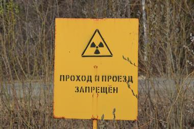 "Radiation warning sign reading ""Walk in and drive in forbidden"", Mayak nuclear reprocessing plant, Chelyabinsk, Russia"