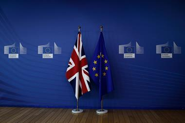 European union flag and flag of the UK at the EU Commission headquarters in Brussels, Belgium on July 19, 2018.