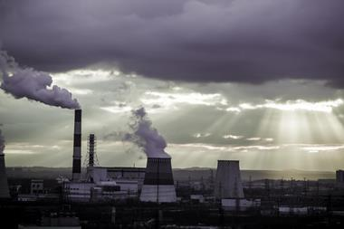 Moody dark clouds over thermal power plant