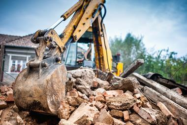Hydraulic excavator machinery working on site demolition