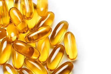 Pile of capsules Omega 3 on white background