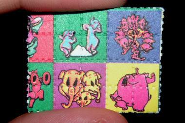 'Pink Elephants on Parade' LSD blotter