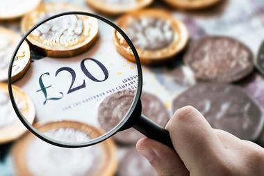 A picture showing a magnifying glass over British pound notes