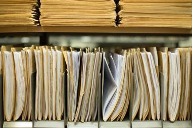 A photograph of old documents in an archive