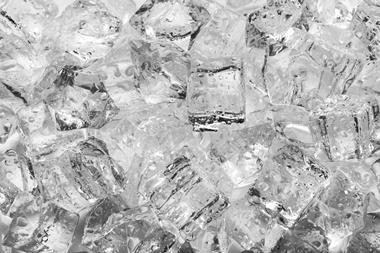 Ice cubes with drops close up
