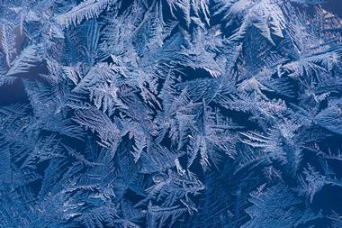 Water ice crystals on glass