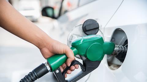 Man fills up the petrol tank in a car