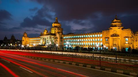 A photograph of traffic in front of Vidhana Soudha, Bangalore