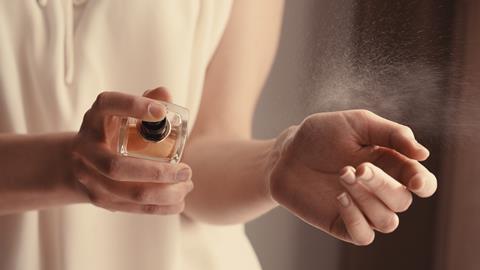 Spraying perfume
