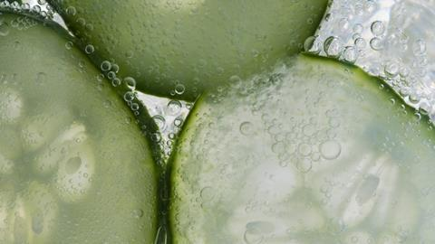 Cucumber in tonic bubbles, close-up