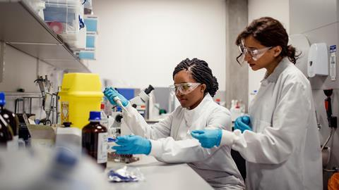 An image showing two female scientists in the lab