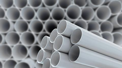 PVC pipes stacked in a warehouse