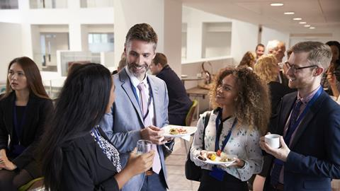 A photograph of people networking at an event