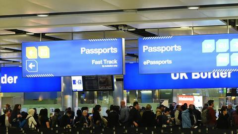 Air travelers queue at border control at Heathrow Airport. Passengers from the EU face uncertainty as the UK government is poised to trigger article 50 to initiate brexit, March 14, 2017.