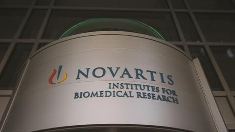 Novartis signage at the Institute for BioMedical Research building in Cambridge, Massachusetts, US