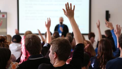 An image showing students Raising Hands During Seminar