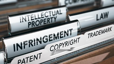Illustration of a folder, focus on a tab with the word infringement.