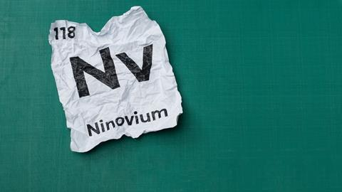 An image showing a scrunched up piece of paper with the details of element 118 - Ninovium - Written down