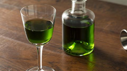 Glass and bottle of absinthe