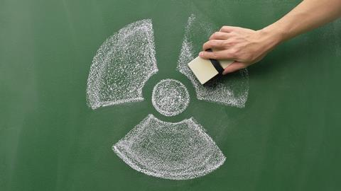 An image showing a radioactive sign being erased