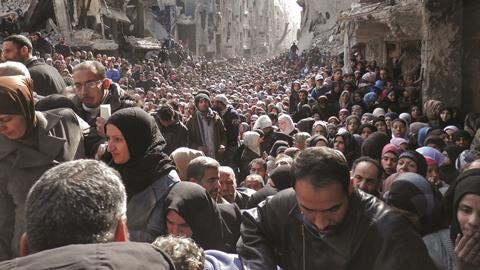 Residents in the Yarmouk refugee camp in Damascus, Syria - Hero
