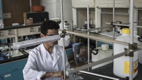 An image showing a student working inside the chemistry lab at the Simon Bolivar University campus in Caracas, Venezuela