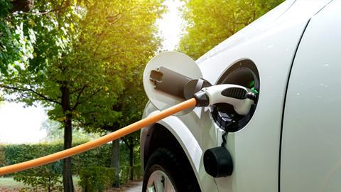 A photo depicting an electric car being charged.