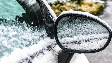 Car door handle covered in snow