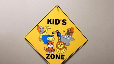 An image showing a kid's zone warning sign