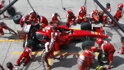Scuderia Ferrari Marlboro crews do pit-stop practice at the 2009 F1 Petronas Malaysian Grand Prix April 4, 2009 in Sepang Malaysia.