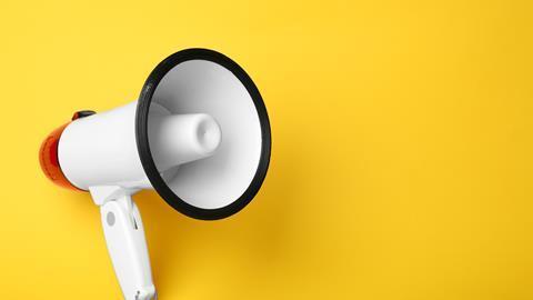Megaphone on yellow background