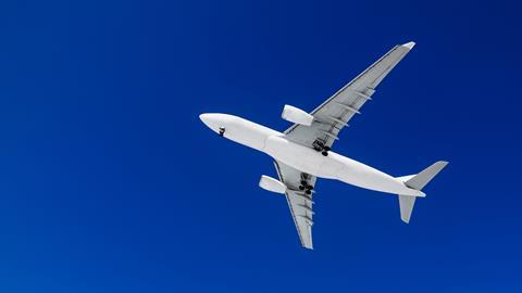 Passenger airplane on a blue sky background.