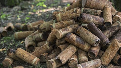 Pile of rusty world war one artillery shells