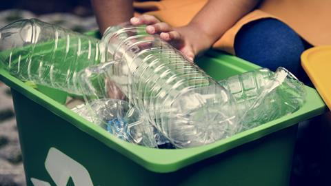 Recycling box filled with clear plastic bottles