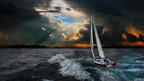 Sailboat in the stormy sea