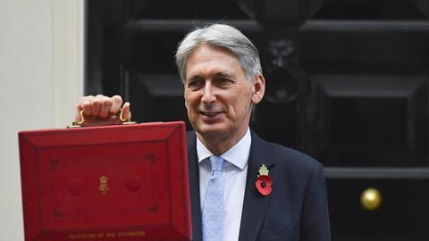 Chancellor of the Exchequer, Philip Hammond, presenting the red Budget Box, 2018