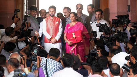 An image showing India's Finance Minister Nirmala Sitharaman Presenting Budget To Parliament