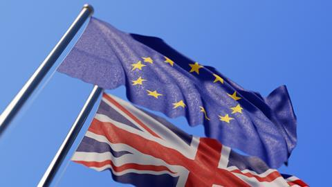 A picture showing flags of the EU and UK
