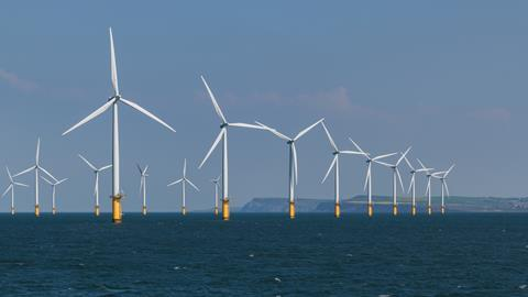 An image showing an offshore windmill farm