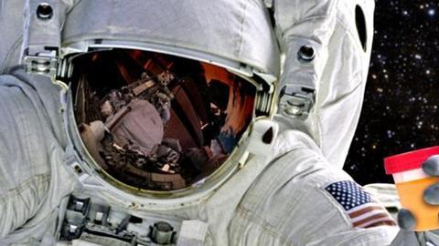 astronaut holding a urine sample
