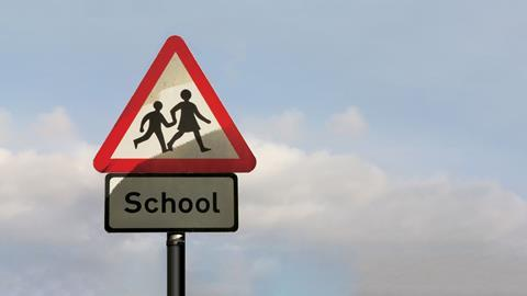 An image showing a children crossing warning sign