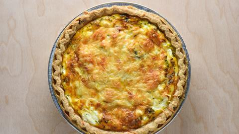 A palte of quiche on a wooden table