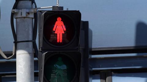 An image showing a red female traffic light