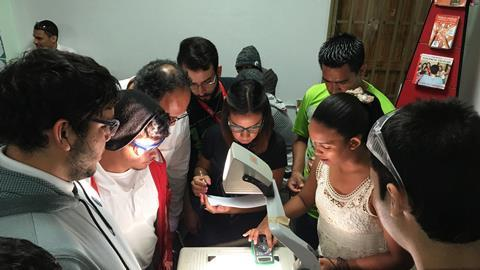An image showing pupils working on an experiment