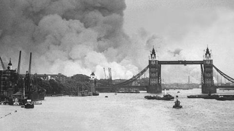 The first mass German air raid on London, during World War 2. Tower Bridge stands out against a background of smoke and fires. Sept. 7, 1940.