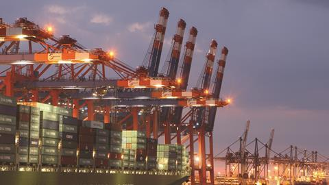A container ship from China Shipping Line is loaded at the main container port in Hamburg, Germany
