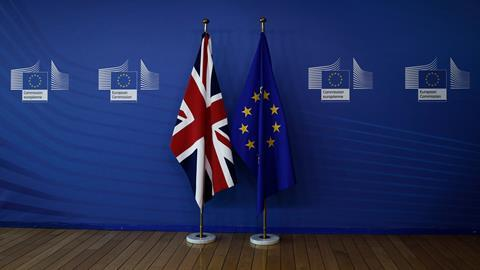 European union flag and flag of the UK at the EU Commission headquarters in Brussels, Belgium on July 19, 2018