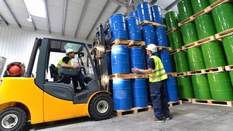 A picture showing a group of workers with forklift